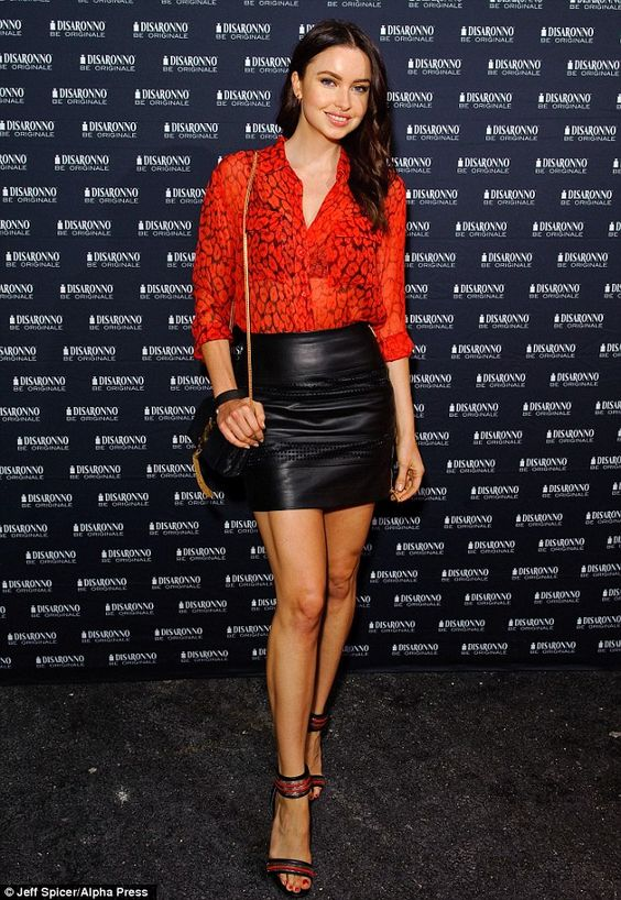 Emma Miller in Red Top and Black Leather Skirt