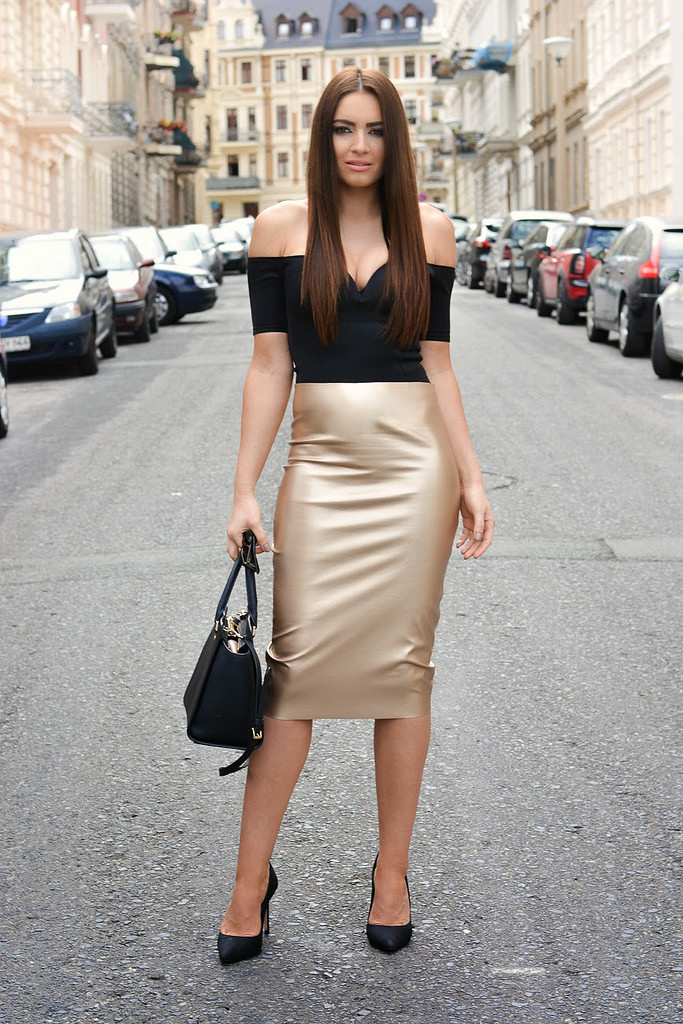 Golden Leather Skirt, Black Top and Black Heels with Black Purse as Accessory