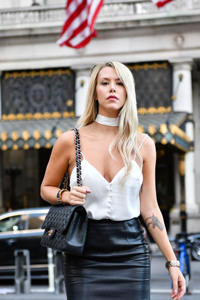 Sleeveless White Top with Black Leather Skirt